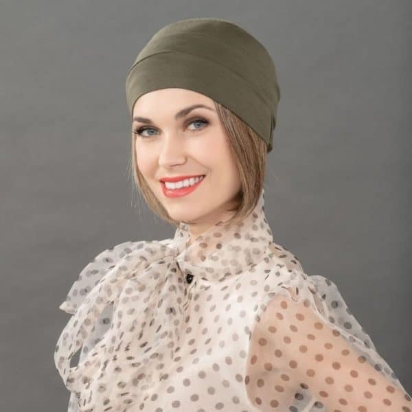 Woman with hair loss wearing a soft bamboo hat.