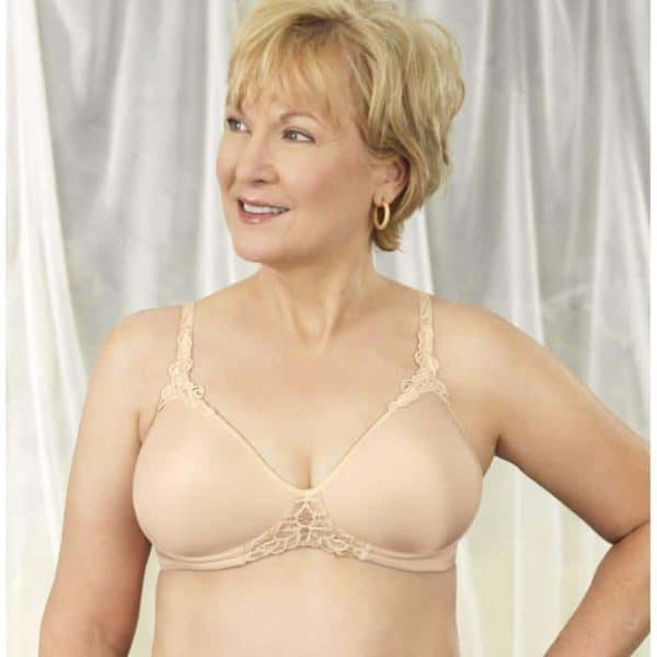 Woman wearing a padded mastectomy bra in nude.