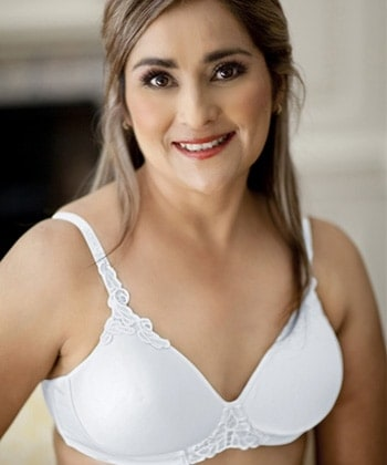 Woman wearing a mastectomy t-shirt white non wired padded bra.