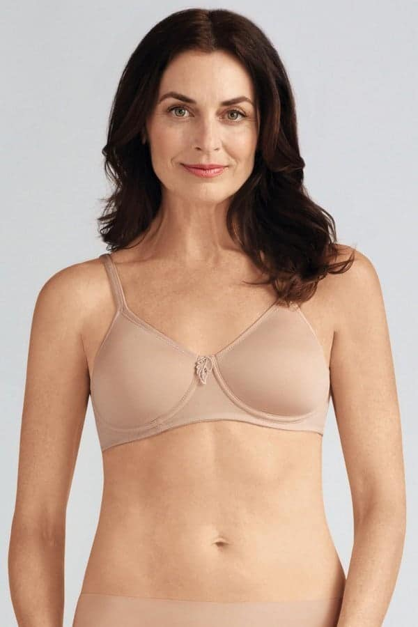 Woman wearing a padded nude mastectomy bra.
