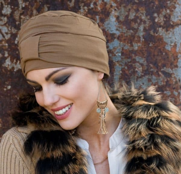 Woman with hair loss wearing a bamboo brown hat.