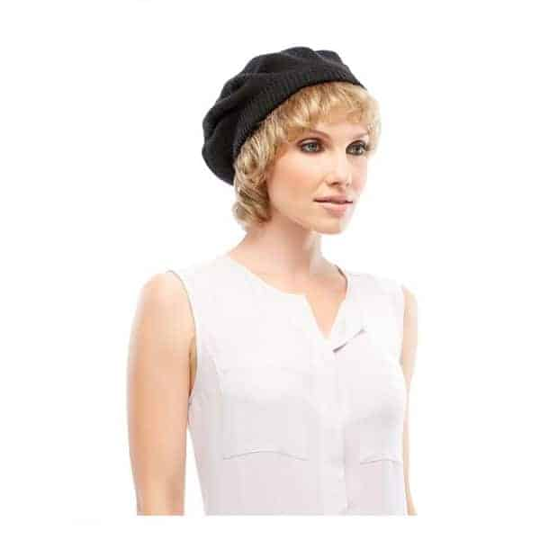 Woman with no hair wearing a Hair Halo Face Framer underneath a hat.
