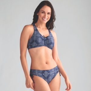 Woman wearing a mastectomy bikini in blue and white.