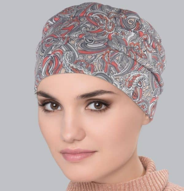 Woman wearing a comfortable Tala Turban Flora Taupe with floral design.