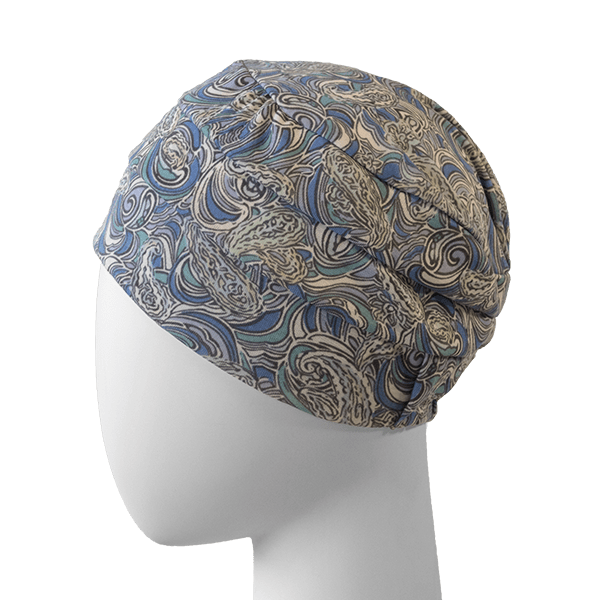 White poly head with a chemo turban in a floral design.