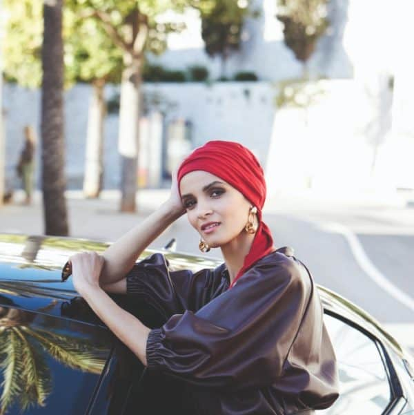 Woman with hair loss wearing a Madrid Patterned Colour Turban with two ties at the nape.