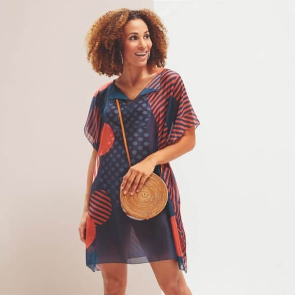 Woman wearing a swimwear tunic for women in navy and dark red.