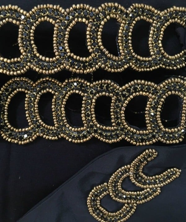 Black colour swatch for headwear fwith golden diadem.