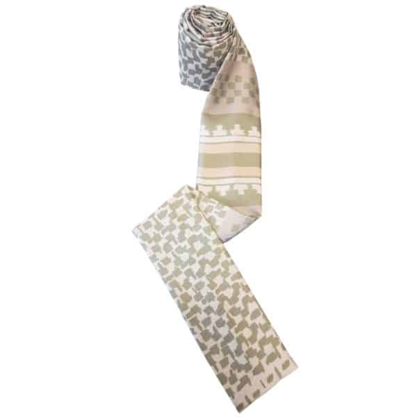 Headscarf for women with hair loss in white with green design.