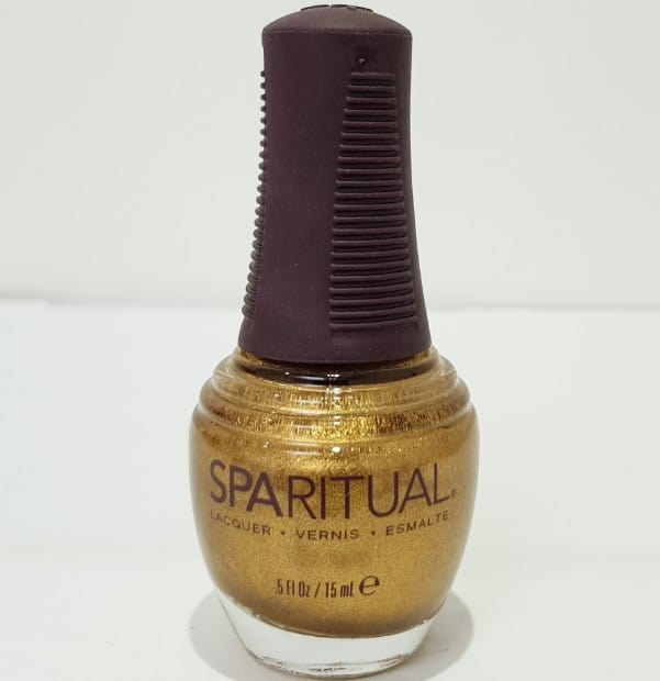 Bottle of golden nail polish chemical free.