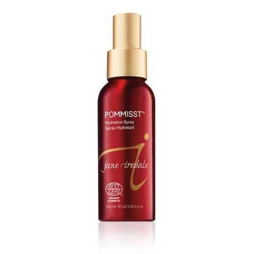 Bottle of organic hydration spray with pomegranate extract for skin.