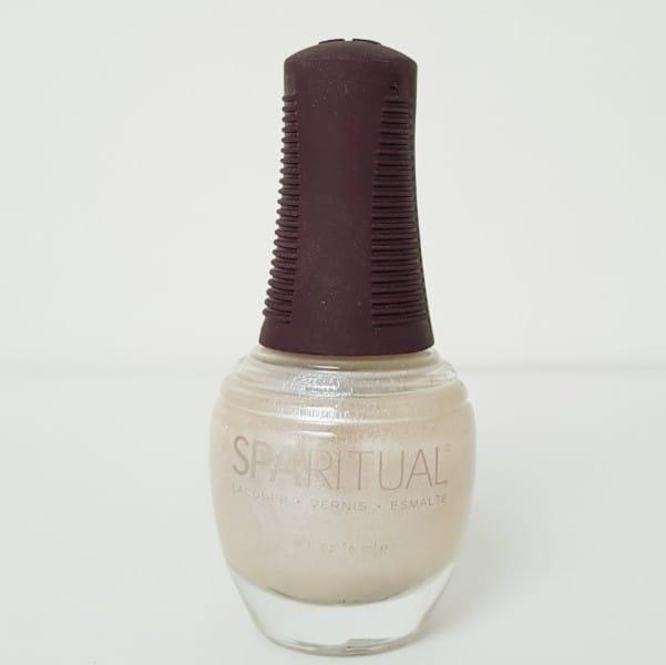 Bottle of white nail polish chemical free.