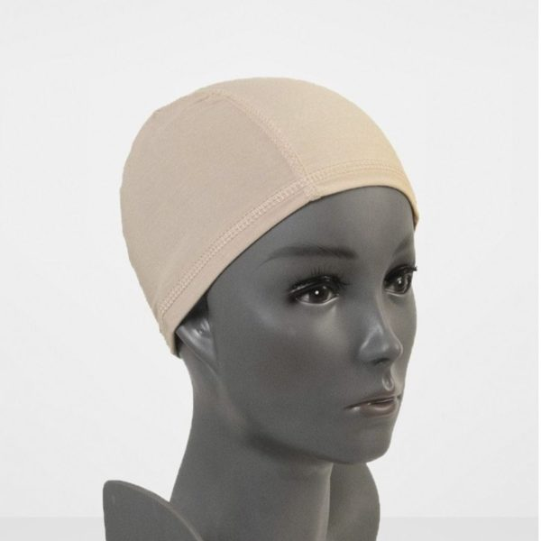 Polyhead with no hair wearing a bamboo wig cap liner.